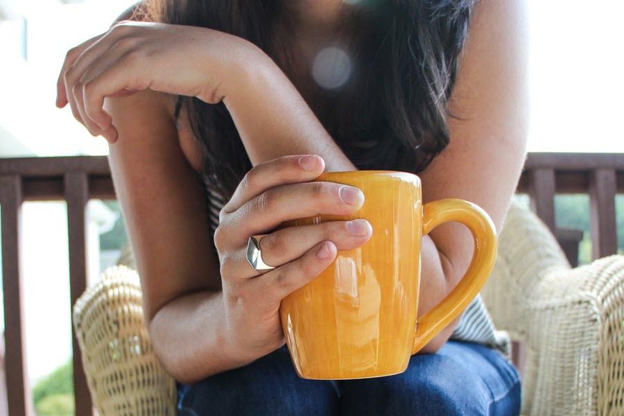 woman holding a yellow mug
